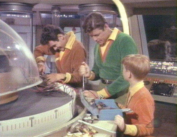Don doing repairs with John Robinson